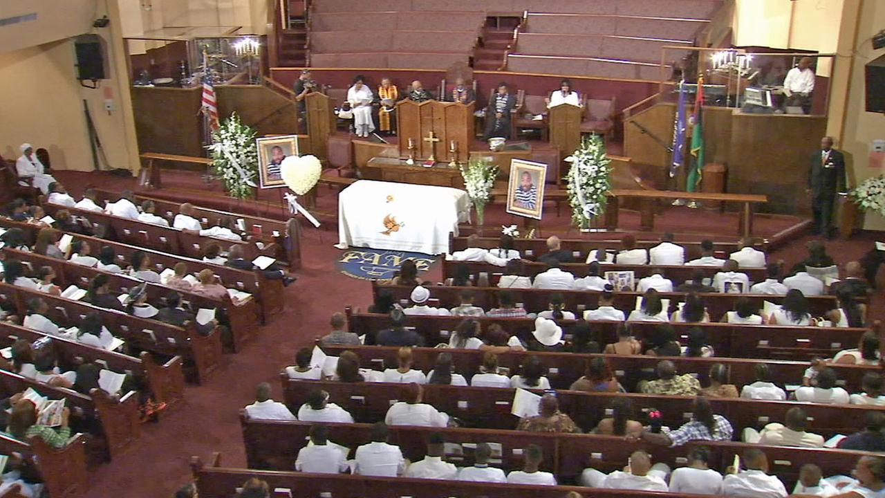 Mourners gather at Ezell Fords funeral in South Los Angeles on Saturday, Aug. 30, 2014.