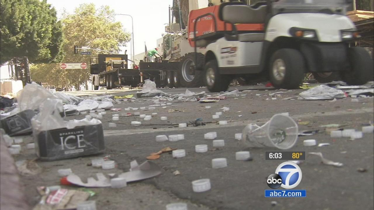 Trash left behind from the Made in America festival in downtown Los Angeles is seen Monday, Sept. 1, 2014.