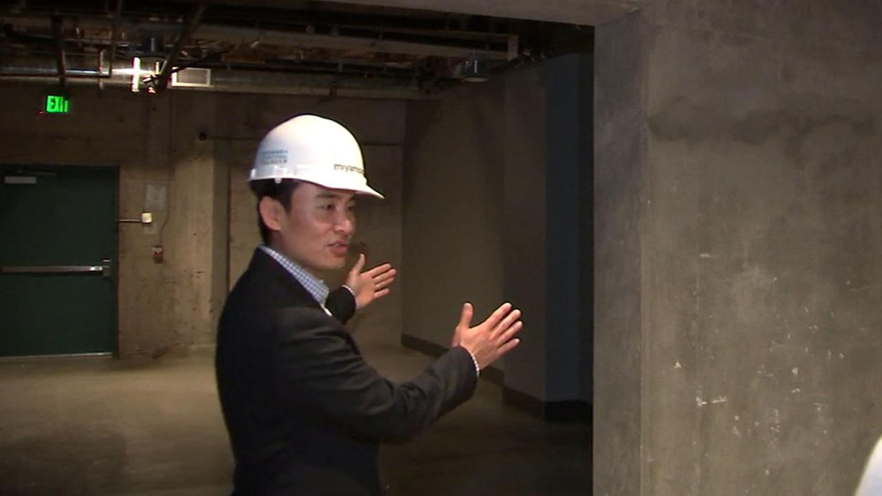Richard Chen, principal with Miyamoto International, Inc., explains seismic retrofitting work recently done at a downtown LA building.