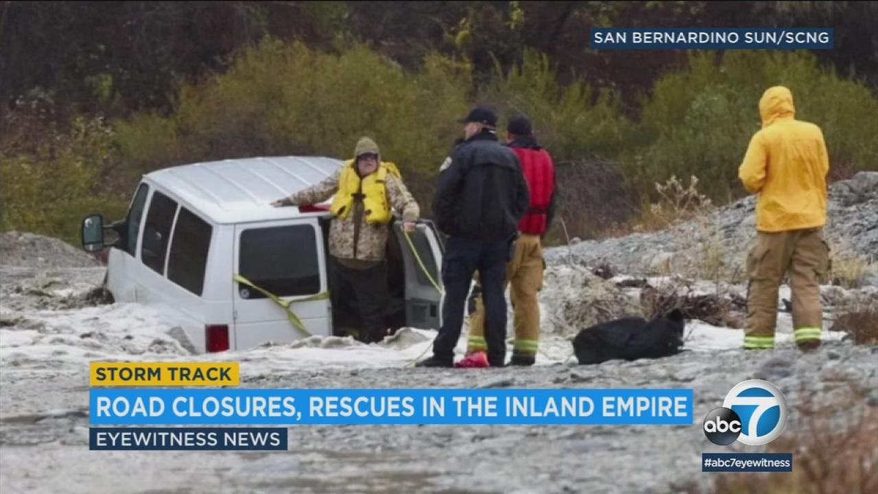 Rushing water in the Inland Empire stranded motorists and closed roadways across the area amid heavy rains Tuesday.