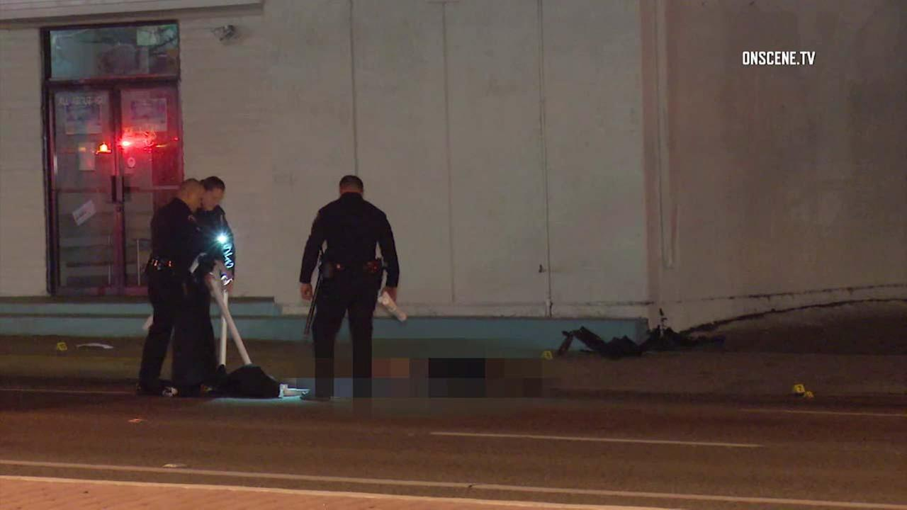 Law enforcement officials investigate the scene of a deadly crash in Santa Ana.