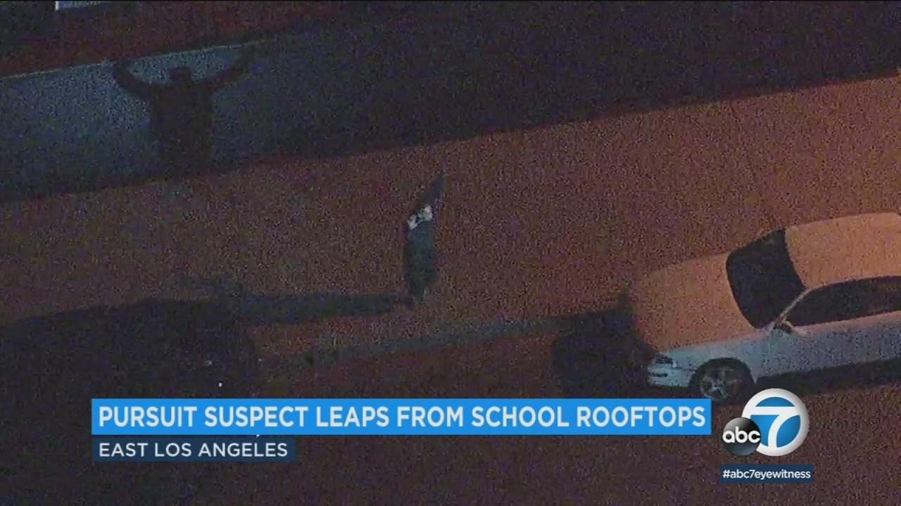 An armed pursuit suspect led police on a wild chase through East Los Angeles and at one point ran across rooftops of a middle school.