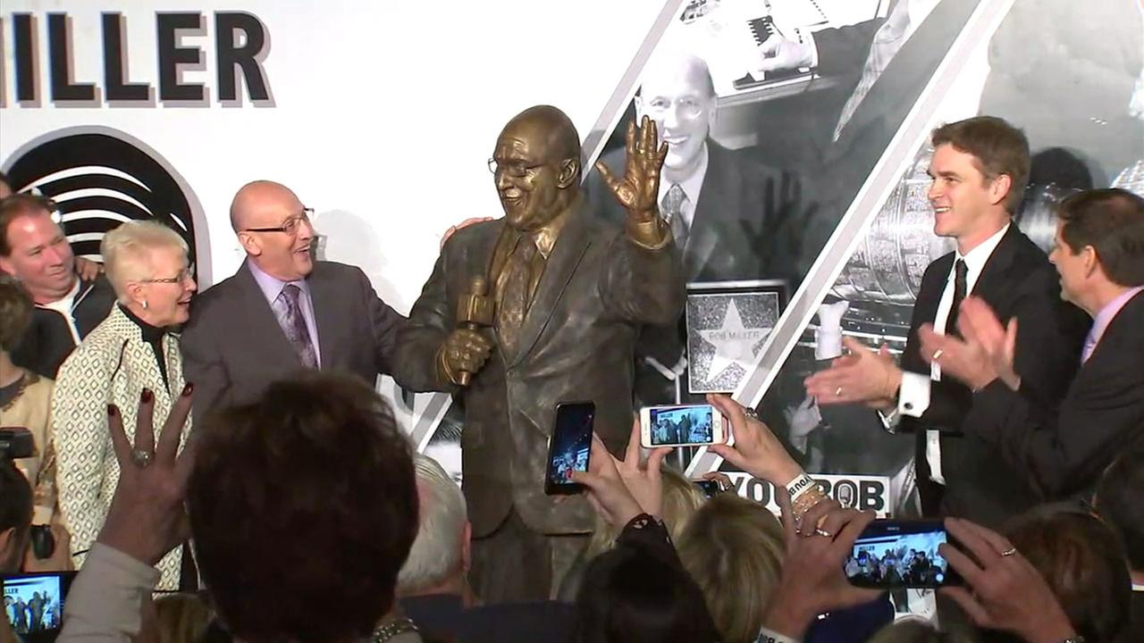 Retired L.A. Kings broadcaster Bob Miller smiles as a statue of him is unveiled on Saturday, Jan. 13, 2018, in front of Staples Center.