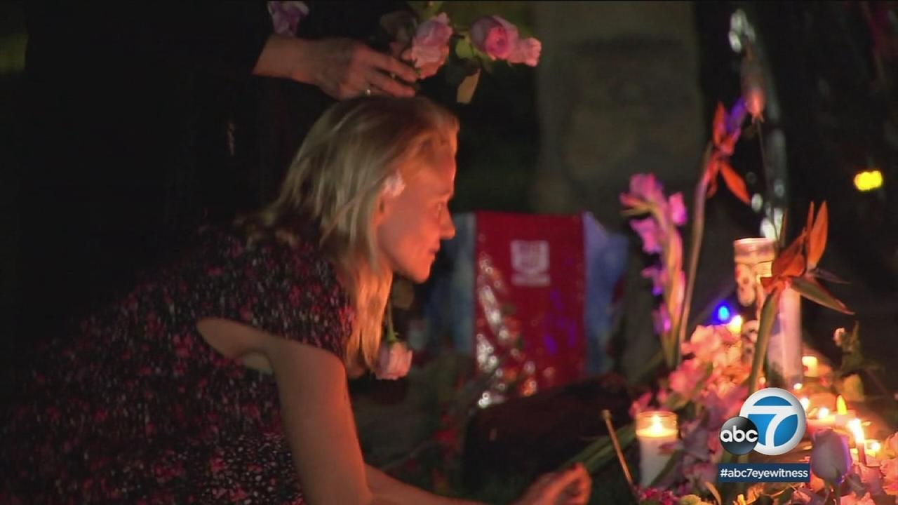 Hundreds of people gathered by candlelight in Santa Barbara to mourn the loss of life suffered in the mudslides that overwhelmed Montecito.