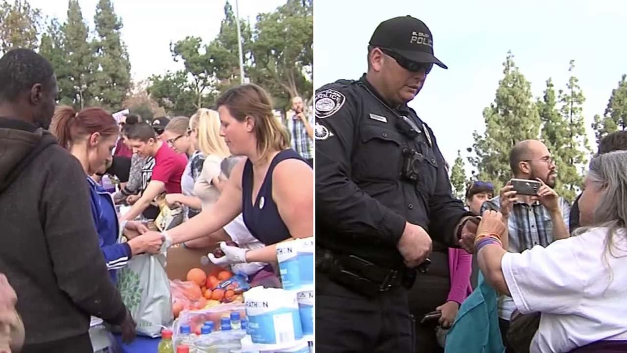 Activists are seen distributing food to the homeless at a San Diego County park.