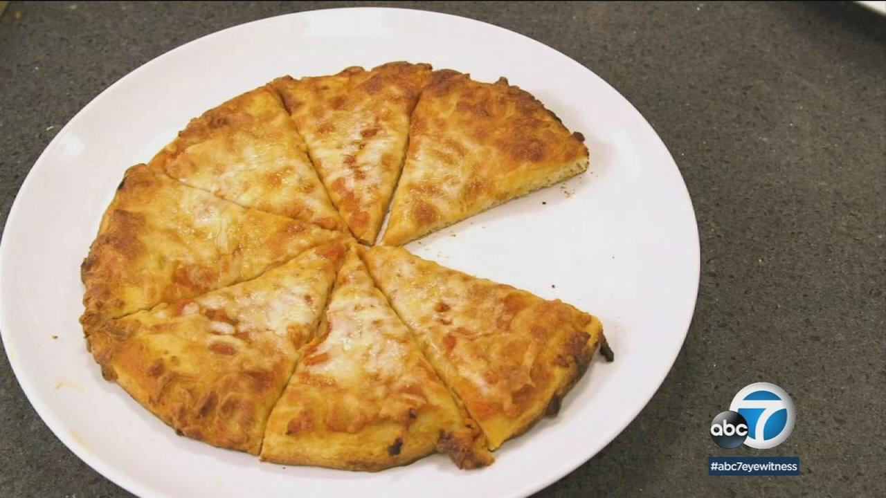 A cheese pizza is shown in a photo.