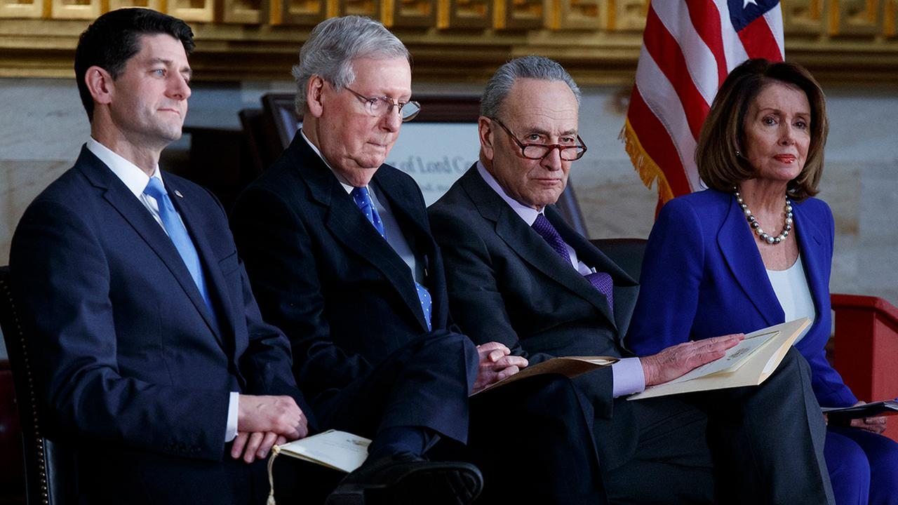 Rep. Paul Ryan, R-Wis., Sen. Mitch McConnell, R-Ky., Sen. Chuck Schumer, D-N.Y., and Rep. Nancy Pelosi, D-Calif., on Capitol Hill, Wednesday, Jan. 17, 2018, in Washington.
