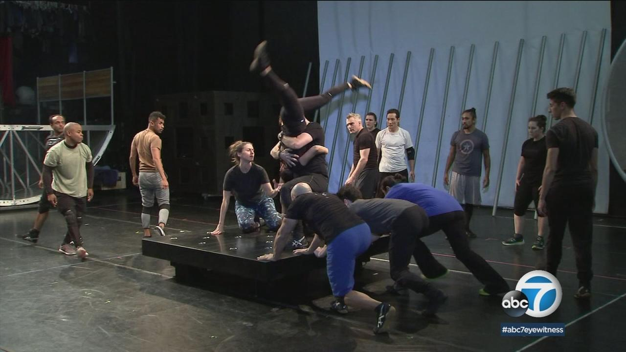 An on-stage performance created as part of the Veterans Project is shown in a photo.