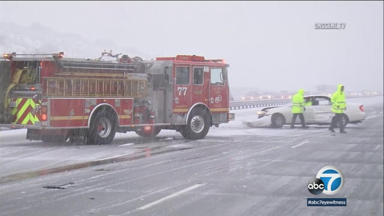 Footage shows snow on the grapevine and fire trucks blocking the roadway to keep motorists safe.