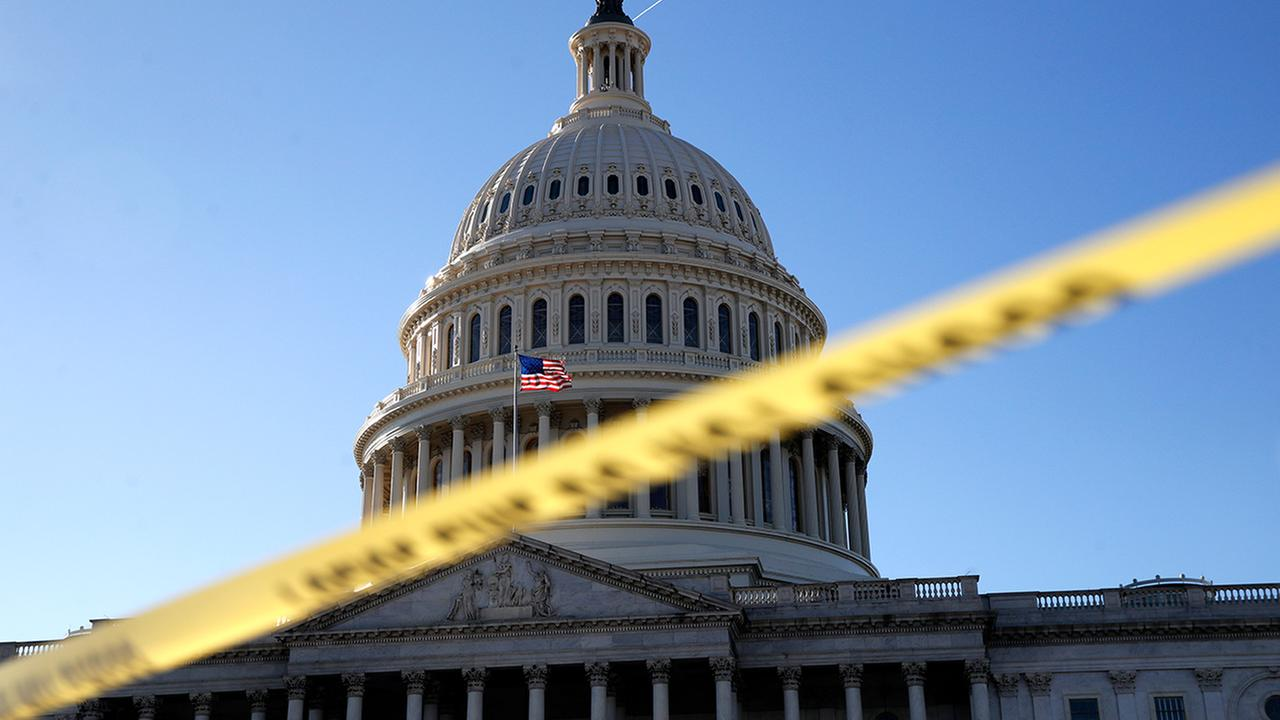Police tape marks a secured area of the Capitol, Friday, Jan. 19, 2018, in Washington, as a bitterly-divided Congress hurtles toward a government shutdown this weekend.