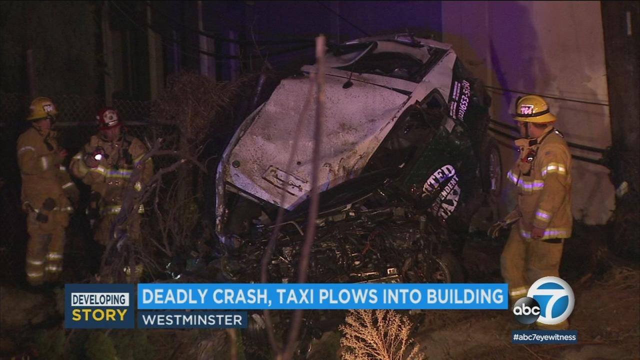A taxi is seen completely wrecked in a fatal crash on the 405 Freeway in Westminster on Sunday, Jan. 21, 2018.