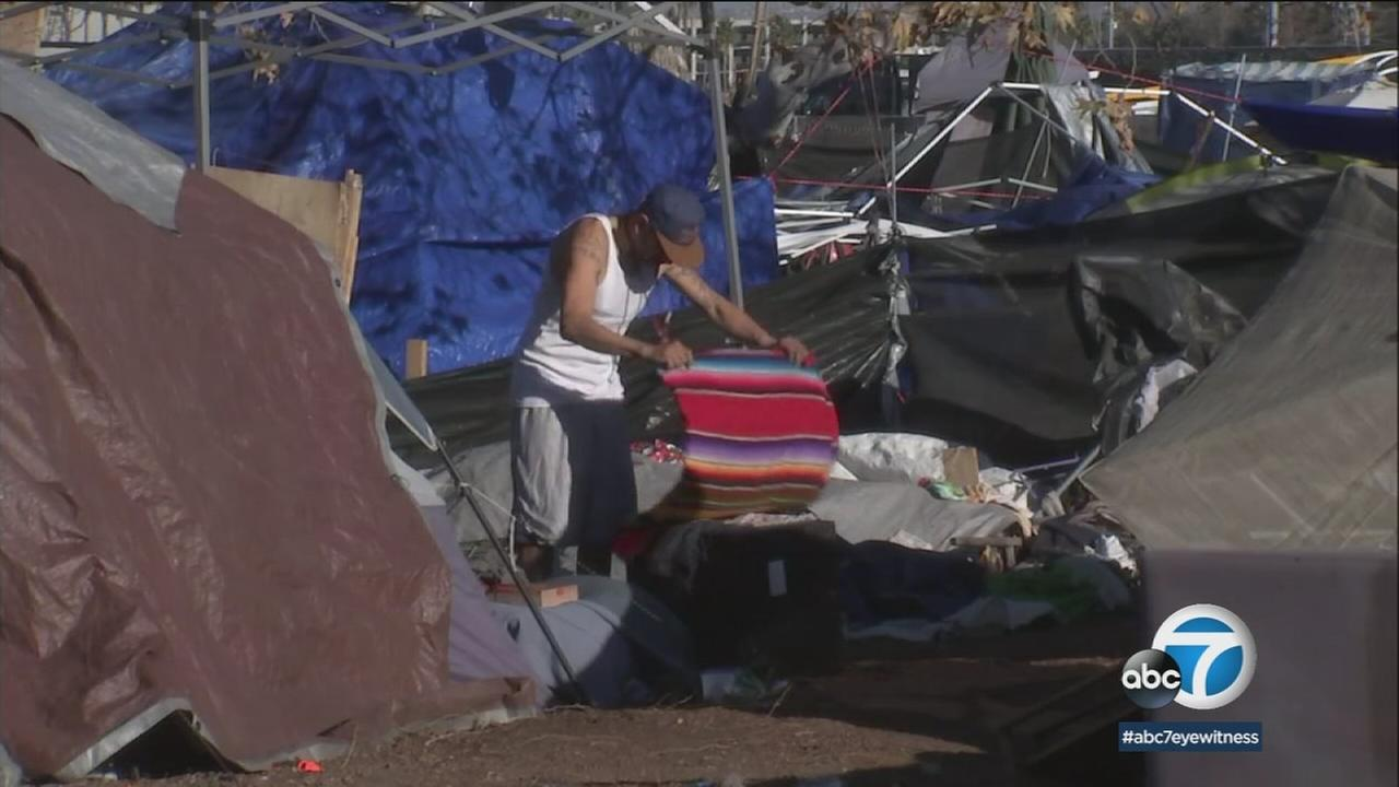 Cleanup is underway at the homeless encampment along the Santa Ana River Trail near Angels Stadium in Anaheim, where nearly 1,000 people live.