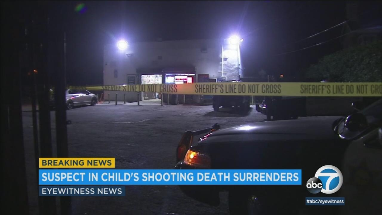 The suspect in a shooting that left a Compton toddler dead Saturday turned himself in to authorities Monday.