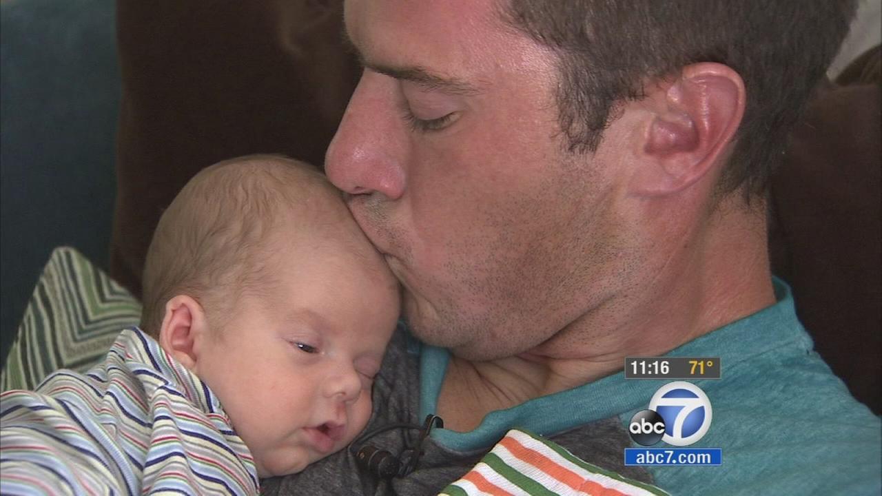 Father Derek Ellison kisses his son Brayden.