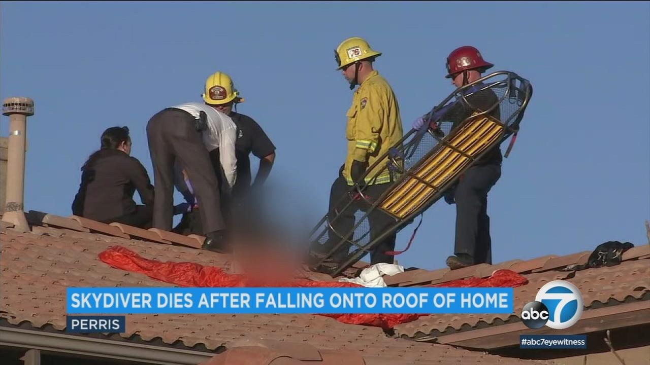 Emergency personnel are seen atop a Perris home after a skydiver crashed on Monday, Jan. 22, 2018.