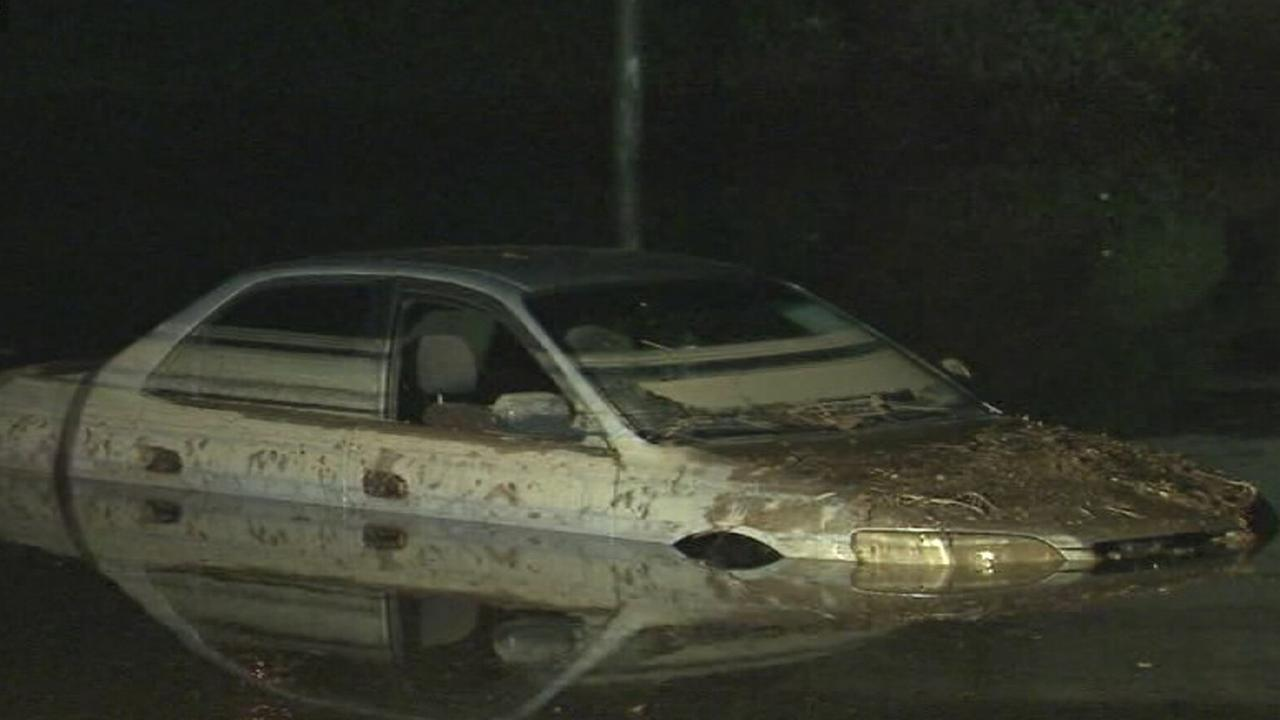 A car is submerged in flood waters in Riverside on Sunday, Sept. 7, 2014.