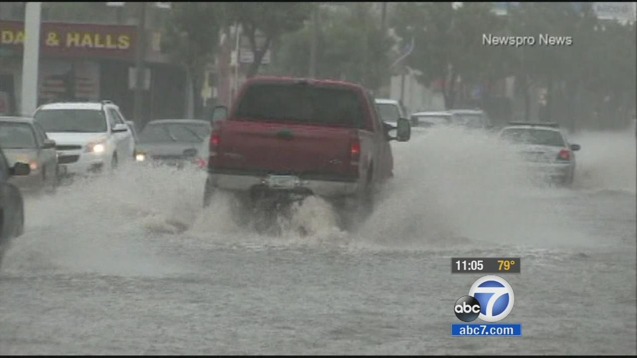 Cars drive through flooded streets in the Inland Empire in this September 2014 photo.