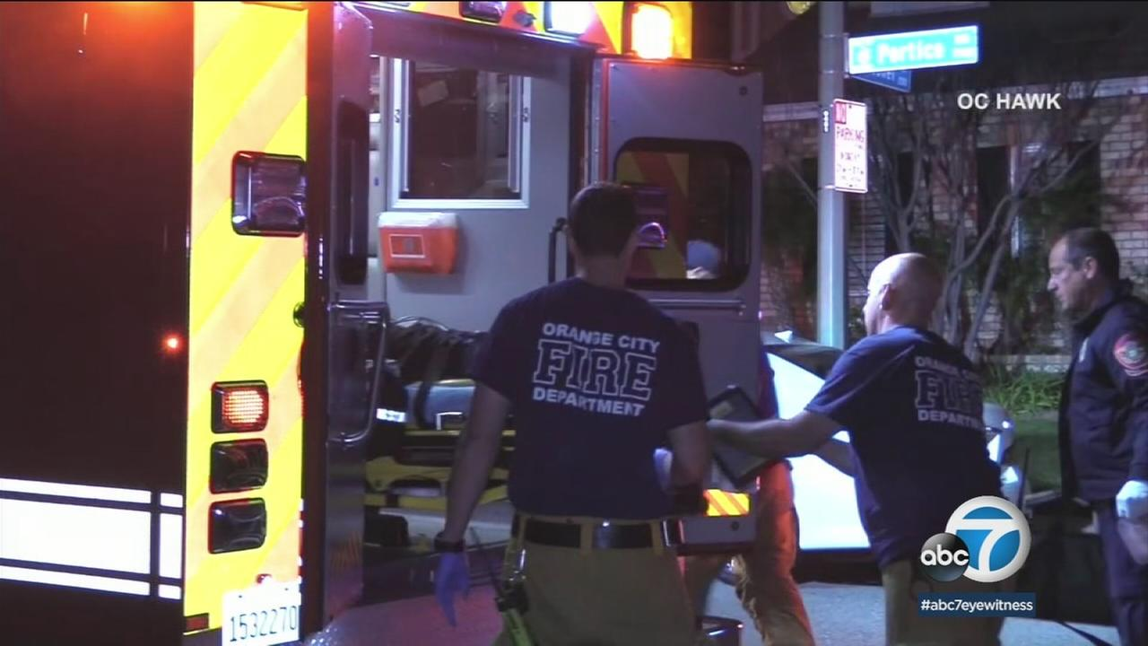 Emergency personnel are seen placing a person into an ambulance on Monday, Jan. 29, 2018.