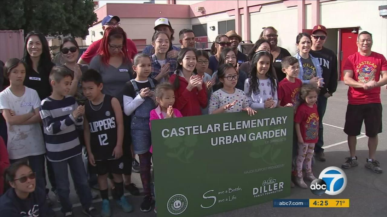 Children at an elementary school that got a community garden from a former ABC7 Cool Kid are shown celebrating the urban garden.