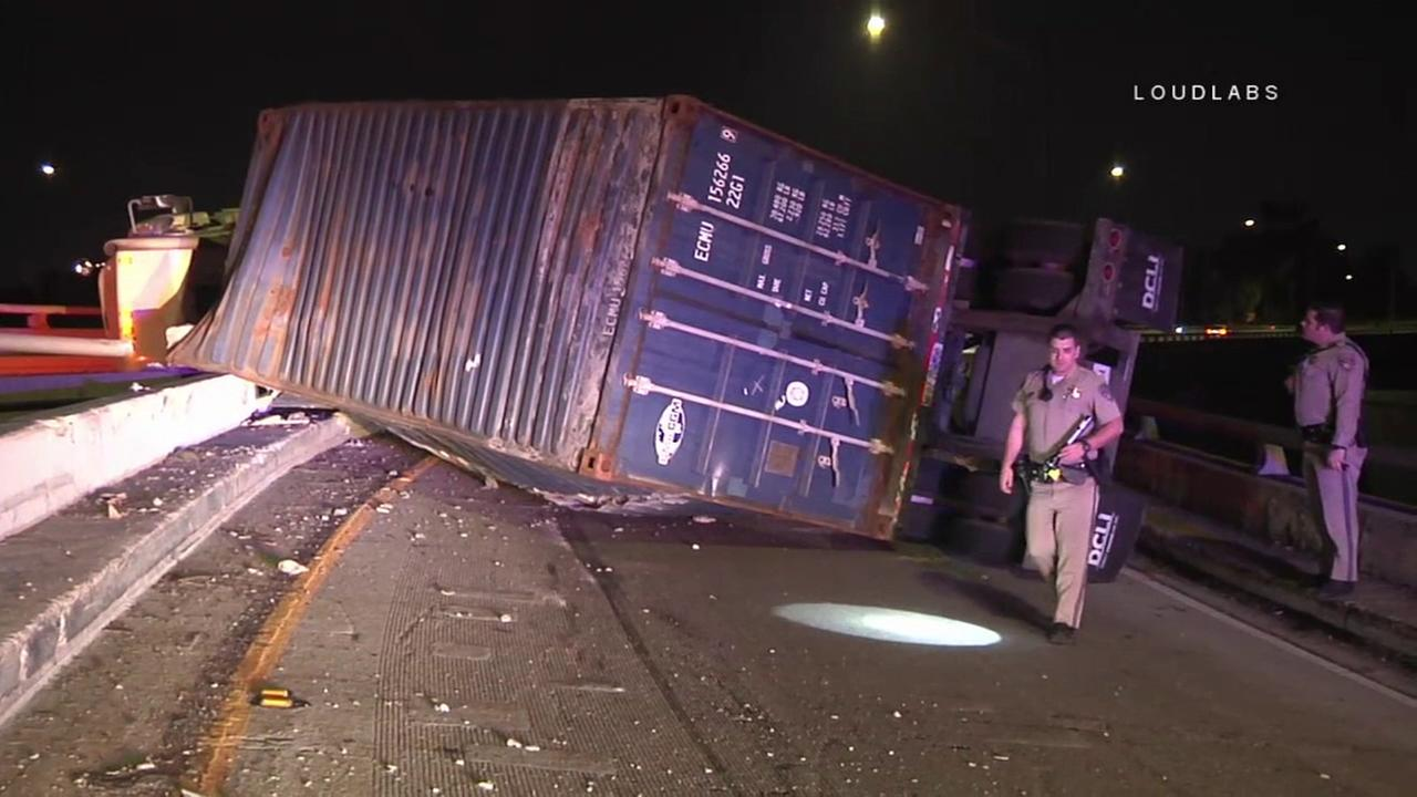 A semi-truck overturned early Tuesday morning on a transition road between the 710 and 405 freeways in Long Beach, prompting the California Highway Patrol to close the connector.