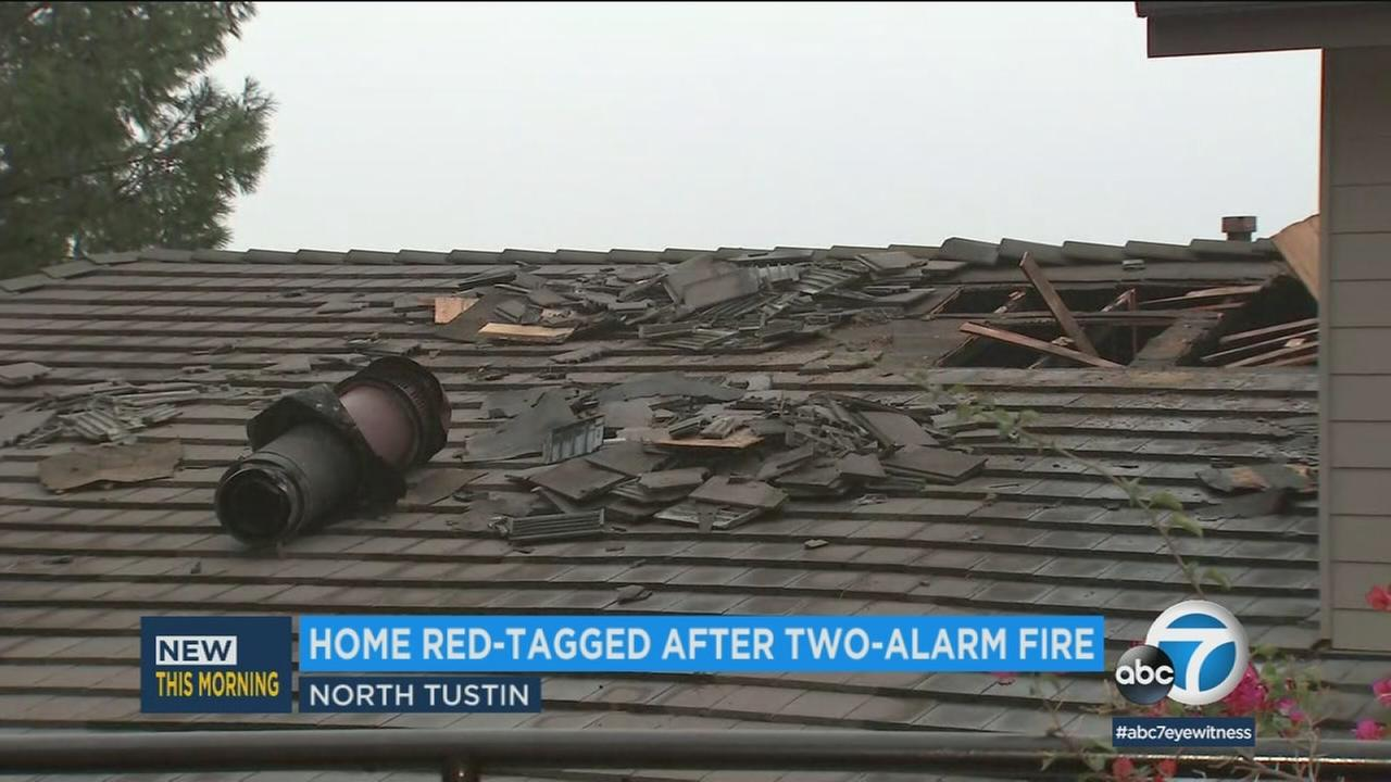 Residents escaped injury and three luxury cars were undamaged in a dramatic house fire that resulted in a Tustin house being red-tagged, officials said.