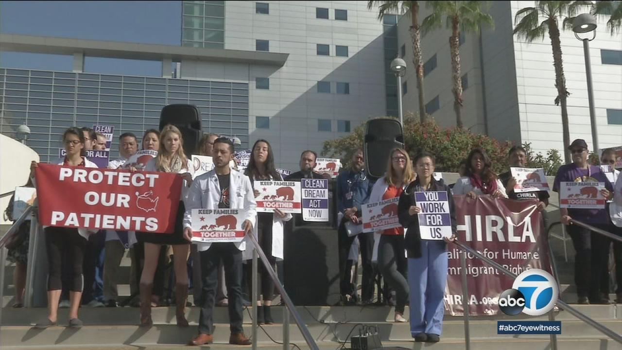 Resident physicians stood on the steps of LAC+USC Medical Center to advocate for a clean DREAM Act and undocumented immigrants.