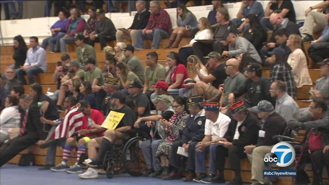 Dozens of parents, veterans and community members gathered in a gym at a Pico Rivera high school to complain about a teachers disparaging comments about the military.