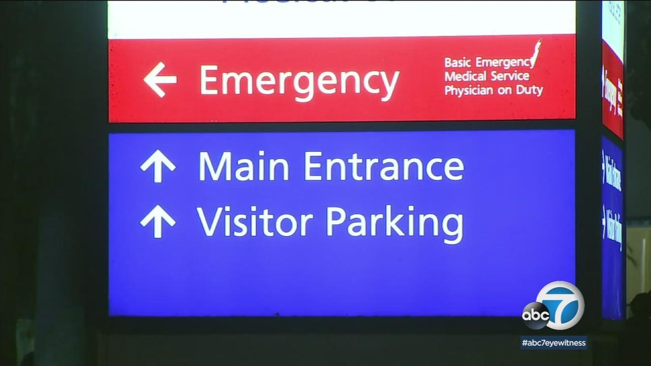 A hospital emergency room sign is shown in a photo.