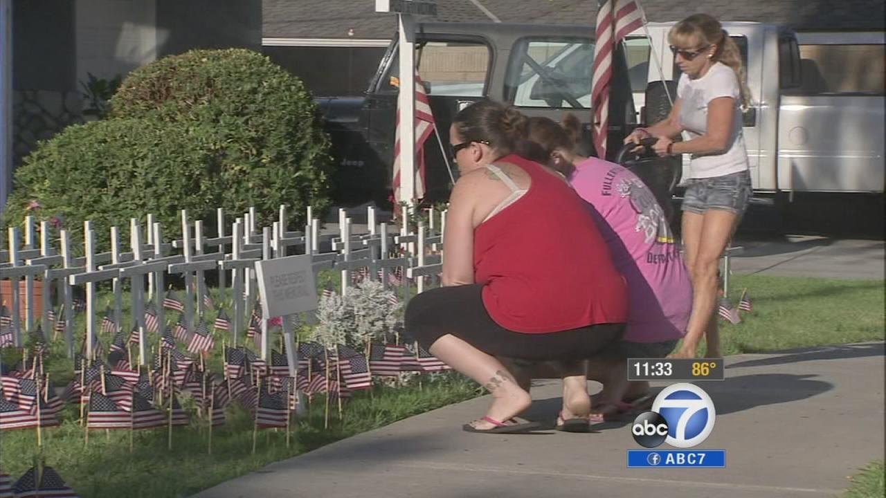 A firefighter in Fullerton is remembering the victims of the Sept. 11 attacks by turning his home into a memorial.