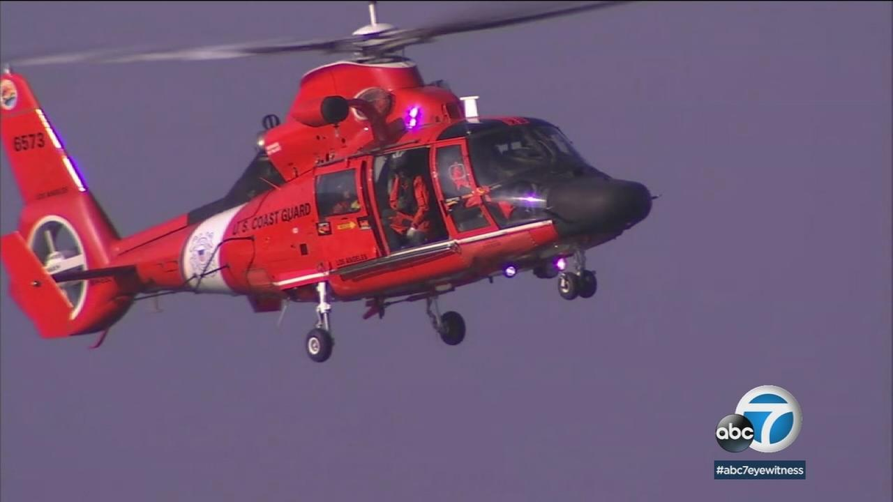 A Coast Guard rescue helicopter is shown in a photo.