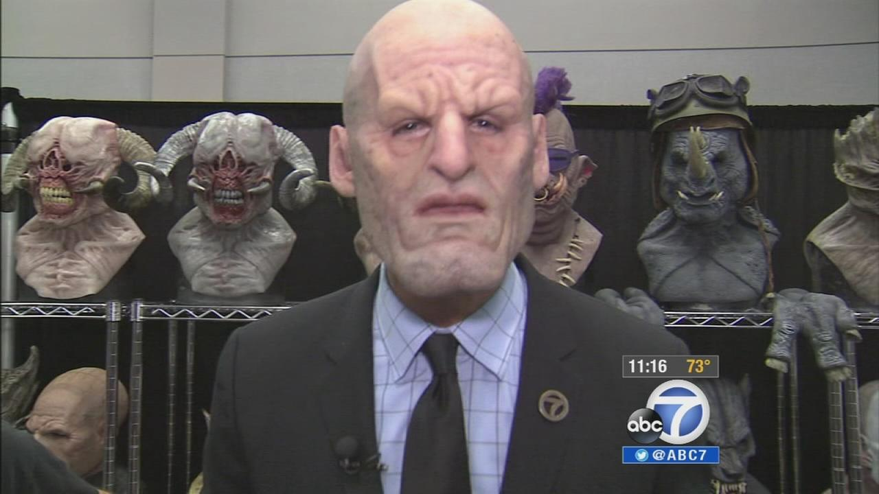 ABC7s Elex Michaelson wears a monster mask at Son of Monsterpalooza in Burbank on Friday, Sept. 12, 2014.
