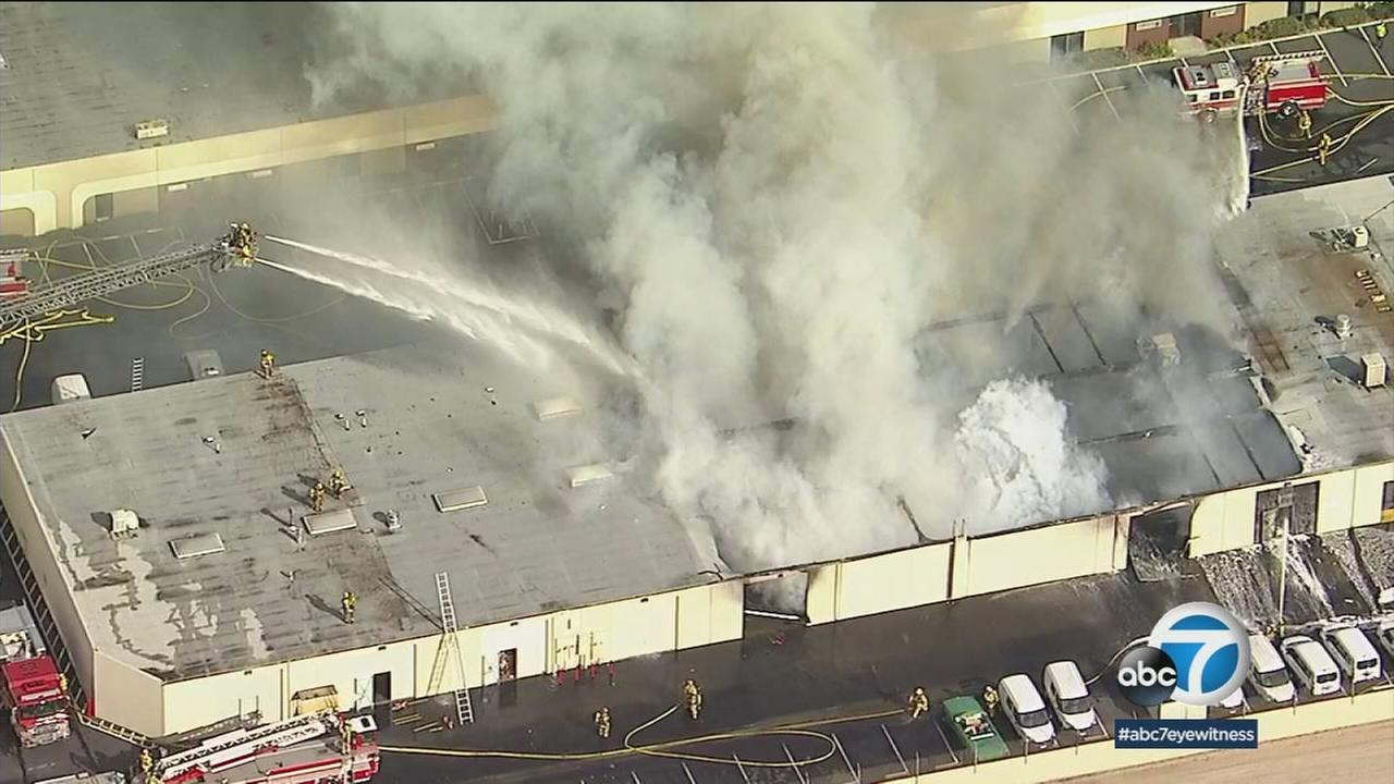 Firefighters rushed to extinguish a fire that ignited inside a commercial building in Anaheim Monday.