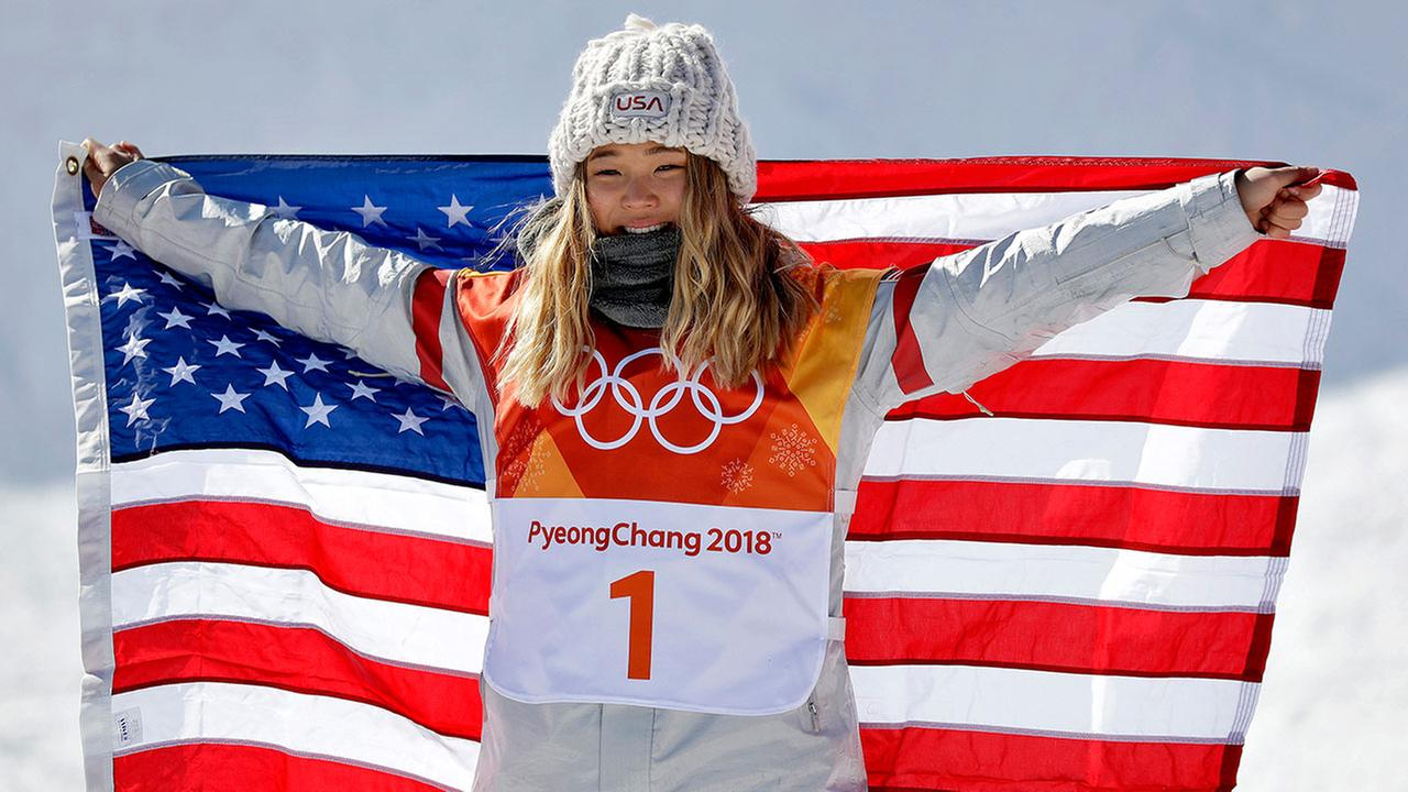 Chloe Kim, of the U.S., celebrates winning gold in the womens halfpipe finals at Phoenix Snow Park at the 2018 Winter Olympics in Pyeongchang, South Korea, Tuesday, Feb. 13, 2018.