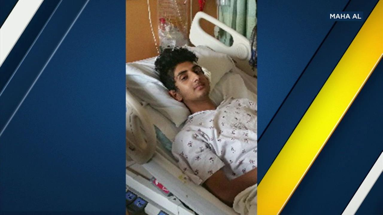 Issa Al-Bayati, 12, is seen recovering in a hospital bed after being shot in the head in his Westlake school classroom.