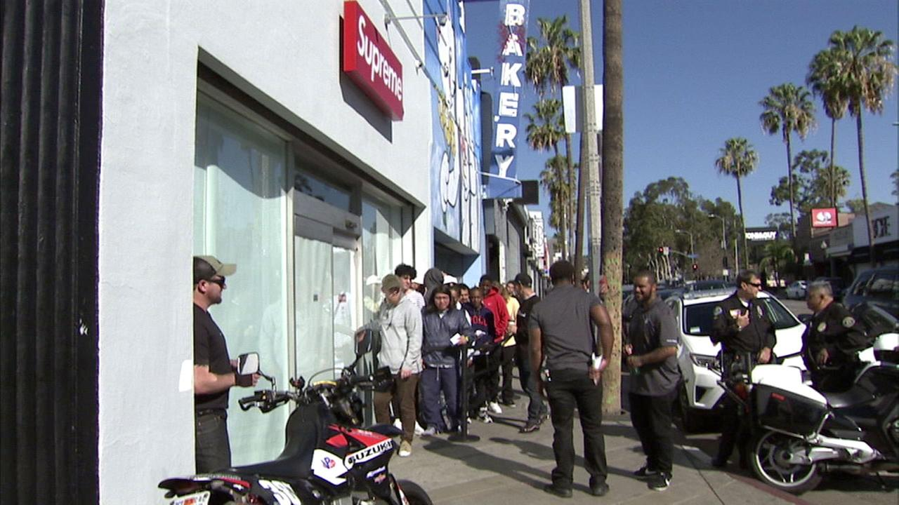 A long line is seen outside the high-end store Supreme in the Fairfax District.