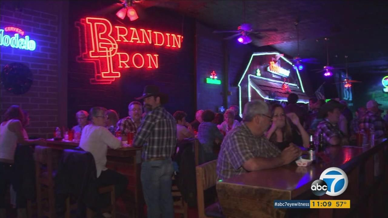 People attending a fundraiser for a Riverside County sheriffs deputy who survived the Las Vegas mass shooting are shown at the Branding Iron in San Bernardino.