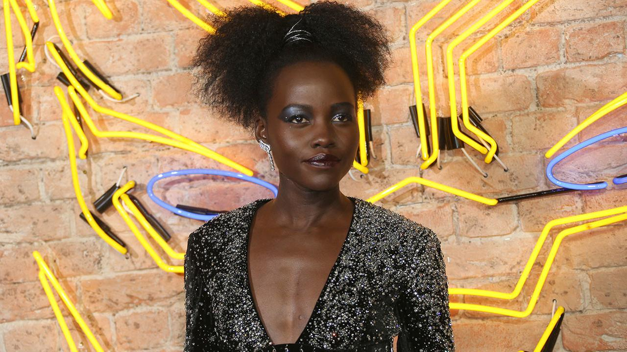 Actress Lupita Nyongo poses for photographers upon arrival at the premiere of the film Black Panther in London, Thursday, Feb. 8, 2018.