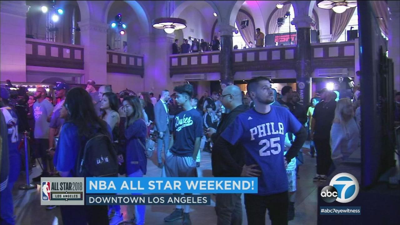 Fans wait around during an event for the NBA All-Star weekend.