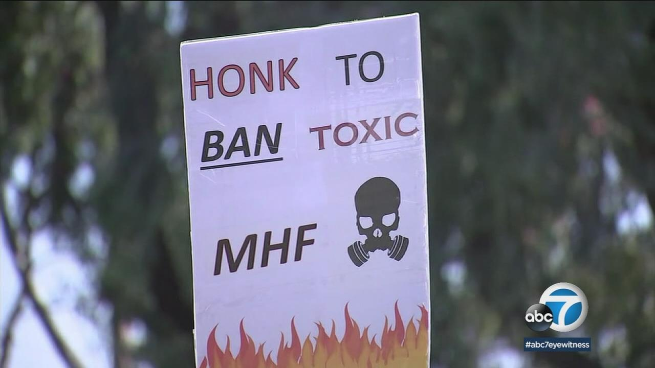 A sign asks for the ban of modified hydrofluoric acid as people protested in front of the Torrance Refinery.