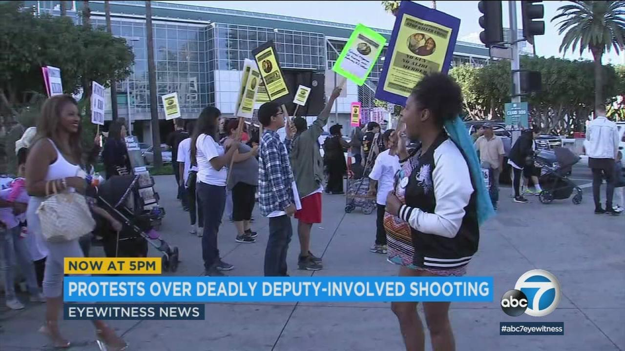Demonstrators protested outside the NBA All-Star Game on Sunday to draw attention to the shooting death of a 16-year-old by deputies.