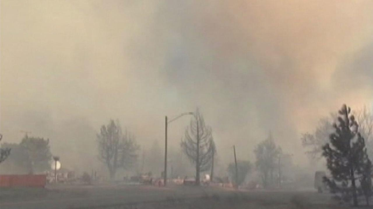 A fire burns in Weed, California, in this September 2014 photo.