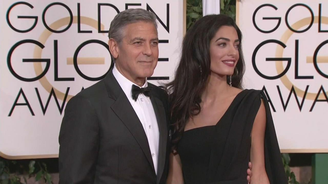 George and Amal Clooney seen at a Golden Globes red carpet.