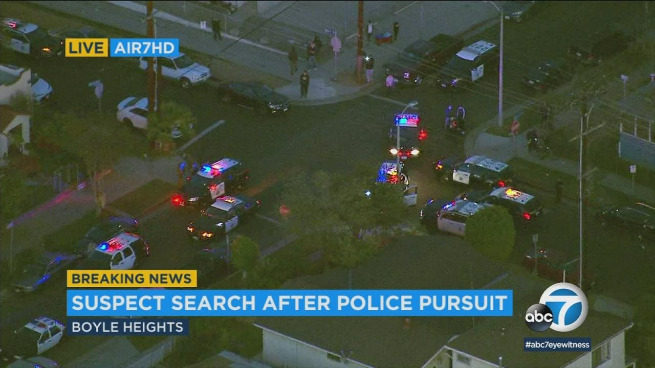 Police are searching for a robbery suspect who struck a pedestrian after leading authorities on a chase in the East L.A. area.