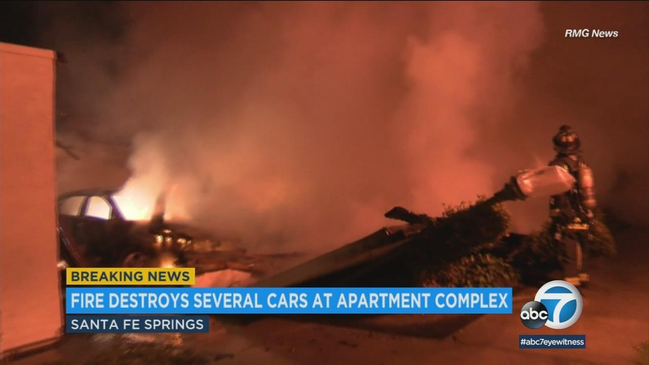 More than a dozen vehicles were destroyed in an early morning fire on Thursday at an apartment complex in Santa Fe Springs.
