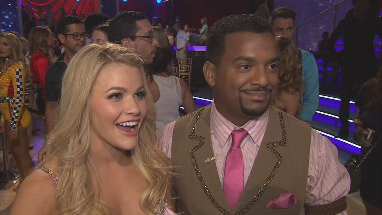 Alfonso Ribeiro and partner Witney Carson talk after the first elimination on Dancing With The Stars Season 19 on Tuesday, Sept. 16, 2014.