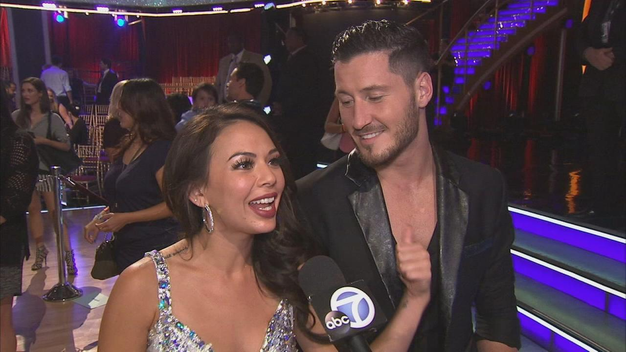 Janel Parrish and partner Val Chmerkovskiy talk after the first elimination on Dancing With The Stars Season 19 on Tuesday, Sept. 16, 2014.
