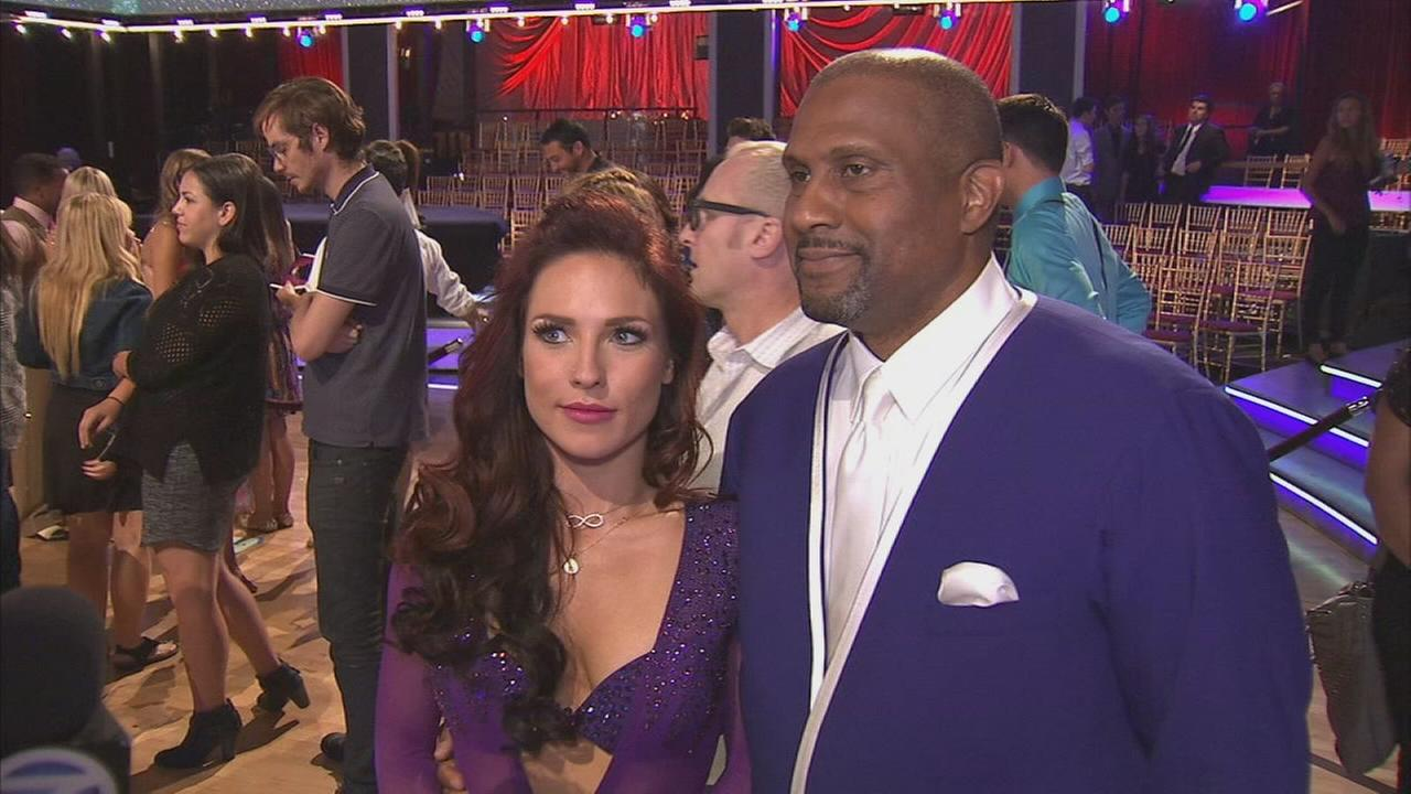 Tavis Smiley and partner Sharna Burgess talk after the Dancing With The Stars: The Results show on Tuesday, Sept. 16, 2014.