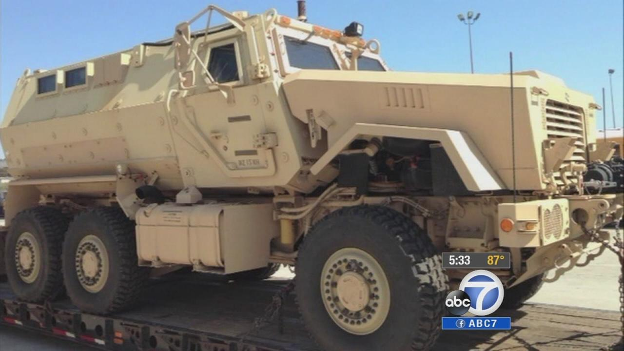 The Los Angeles Unified School District returns three grenade launchers and keeps an armored vehicle and assault rifles received through a federal program.