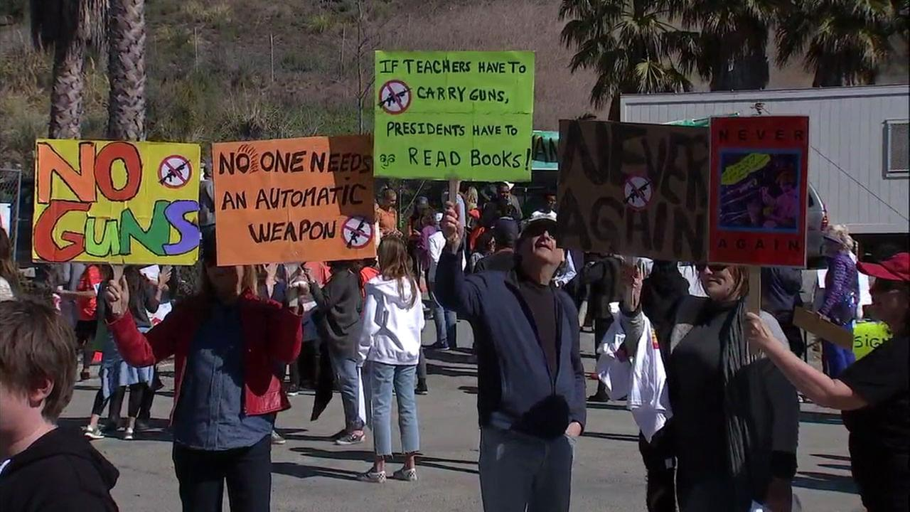 Protesters hold up signs as they push for better gun control in the wake of the Parkland school shooting.
