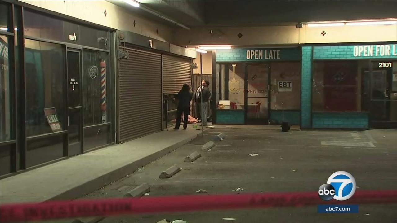 An armed burglary suspect was shot and killed in a confrontation with officers at a South Los Angeles marijuana dispensary, police said.